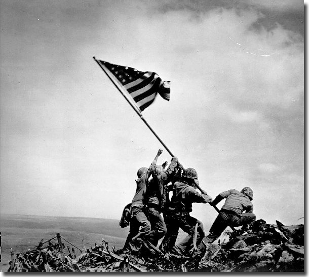 The raising of OLD GLORY at Iwo Jima.