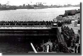 Troops at the end of their tether wait to join ships and escape from St Nazaire.