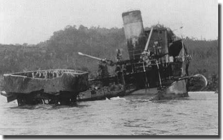 Dutch Destroyer Evertsen, beached on a coastal reef near Seboekoe Besar, the stern blown off by an explosion in her aft magazine. Her crew escaped to land, and were taken POW over March 9/10 1942. Her Captain died as a POW.