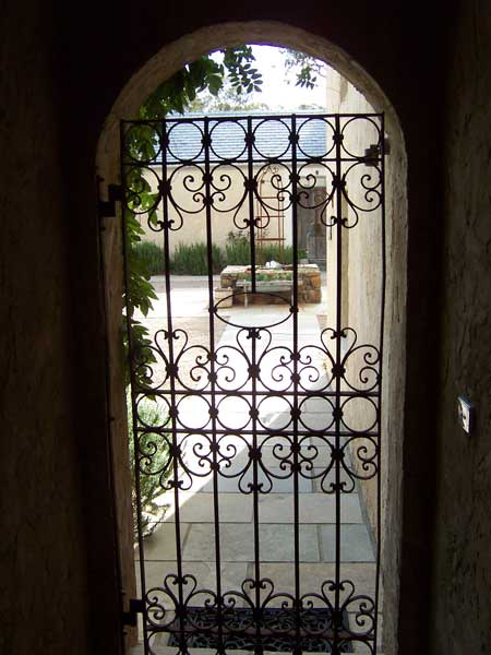 Wrought iron gate, arch and Courtyard