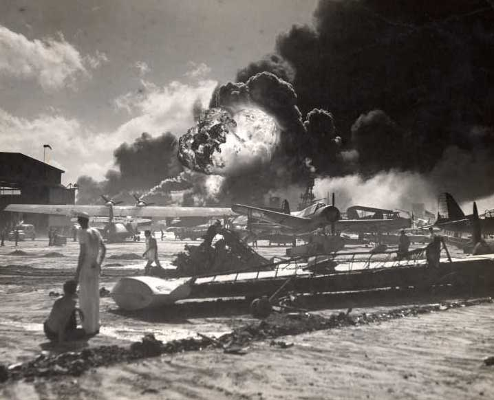 US aircraft burn after the Japanese carrier borne aircraft attack on December 7. 1941.