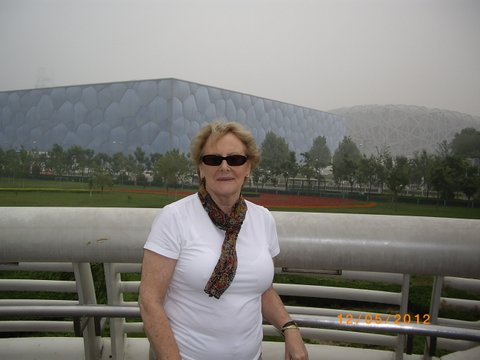 Denise outside the Olympic Stadium at Beijing