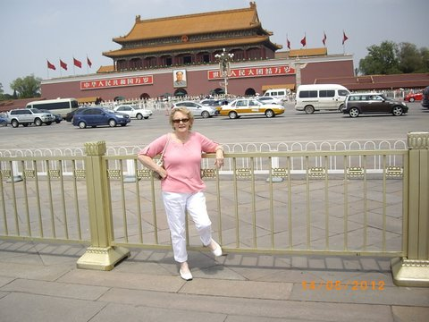 Denise in front of the Forbidden City entrance at Beijing