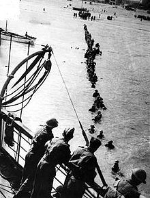 British troops wade out to waiting ships at Dunkirk