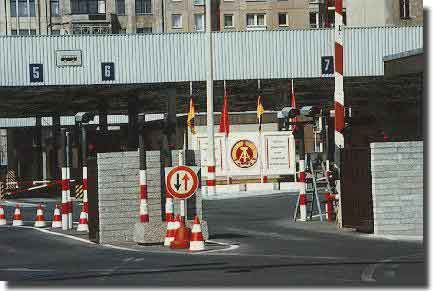 Check Point Charlie, in the Wall, to cross from West to East and vice versa