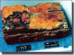 This rusty box of spare parts recovered from the wreck, gave her number as U-869 and the submarine's manufacturer
