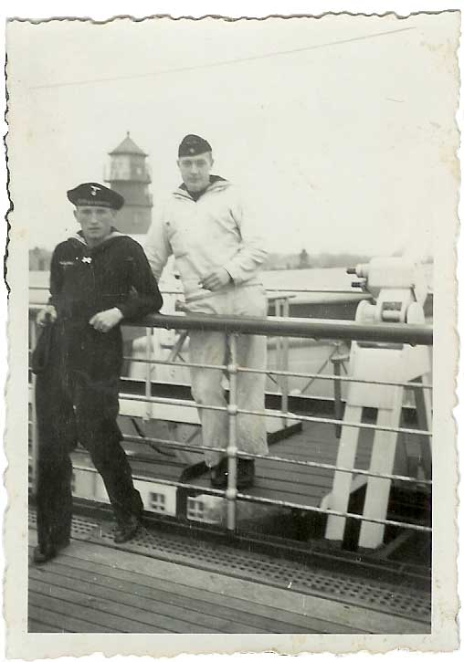 Willy's brother Georg who was lost in a U-Boat in October 1943 is in the dark uniform. 