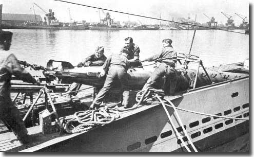 Loading a torpedo into a German U-Boat