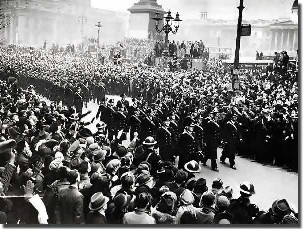 Crews from Exeter and Ajax, march through London in February of 1940, to receive a heroes welcome home