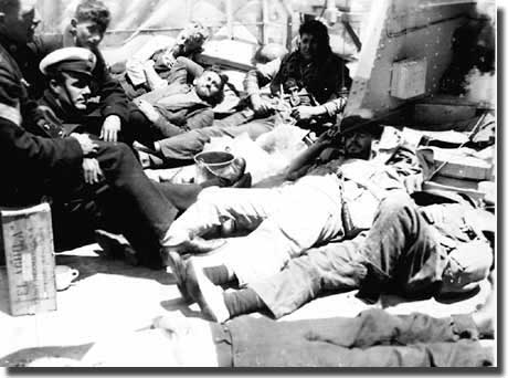 Men resting on deck of Achilles after the Battle of the River Plate