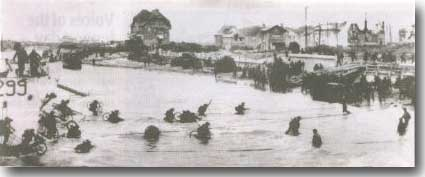 Troops wade ashore on the 6th. of June 1944. D Day