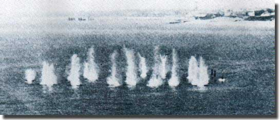 A salvo of Hedgehog projectiles in the water with three about to arrive on the right