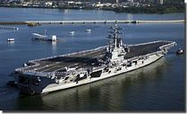 USS Reagan passes the USS Arizona Memorial - click to learn more